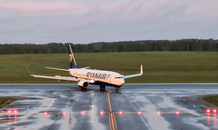 A Ryanair aircraft, which was carrying Belarusian opposition blogger and activist Roman Protasevich and diverted to Belarus, where authorities detained him, lands at Vilnius Airport in Vilnius, Lithuania, on May 23, 2021. (Andrius Sytas/Reuters)