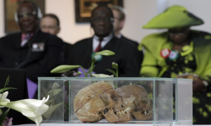 Skulls of Ovaherero and Nama people are displayed during a devotion attended by representatives of the tribes from Namibia in Berlin, Germany, on Sept. 29, 2011. (Michael Sohn/AP Photo)