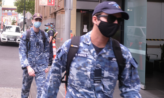 Australian Defence Force (ADF) personnel are seen arriving at the Pullman Hotel on February 11, 2021 in Melbourne, Australia. (Luis Ascui/Getty Images)