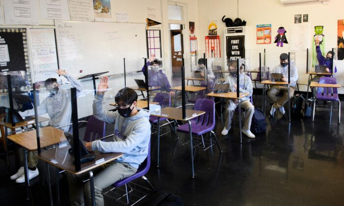 Students attend an in-person English class at St. Anthony Catholic High School in Long Beach, Calif., on March 24, 2021. (Patrick T. Fallon/AFP via Getty Images)