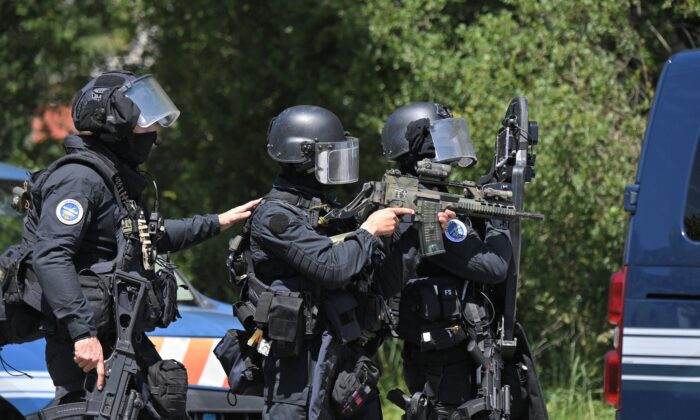 Members of the National Gendarmerie Intervention Group (GIGN) are seen after a municipal policewoman was attacked with a knife in La Chapelle-sur-Erdre, near Nantes, western France, on May 28, 2021. (Loic Venance/AFP via Getty Images)