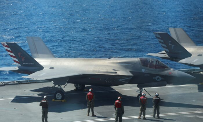 F-35B Lightning II aircrafts are seen on the deck of the HMS Queen Elizabeth aircraft carrier offshore Portugal, on May 27, 2021. (Bart Biesemans/Reuters)
