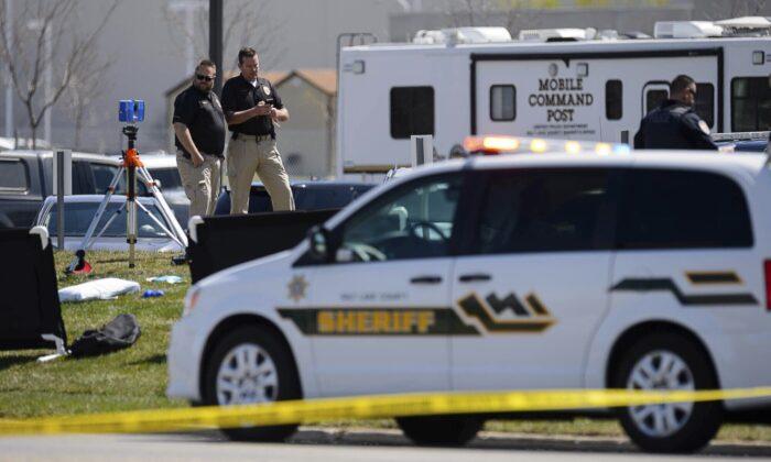 Police at the scene of a shooting at the Salt Lake County Sheriff's Office in Salt Lake City, Utah, on April 10, 2021. (Trent Nelson/file/The Salt Lake Tribune via AP)