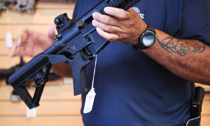 In this file photo,a  bump stock was installed on an AR-15 rifle. (Jim Watson/AFP via Getty Images)