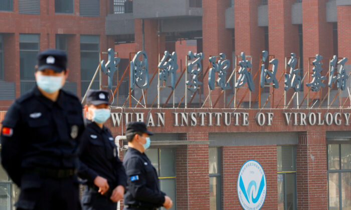 Security personnel keep watch outside the Wuhan Institute of Virology during the visit by the World Health Organization (WHO) team tasked with investigating the origins of COVID-19, in Wuhan, Hubei Province, China, on Feb. 3, 2021. (Thomas Peter/Reuters)