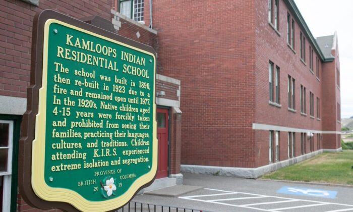 A plaque is seen outside the former Kamloops Indian Residential School on the Tk'emlúps te Secwépemc First Nation in Kamloops, B.C., on May 27, 2021. (The Canadian Press/Andrew Snucins)