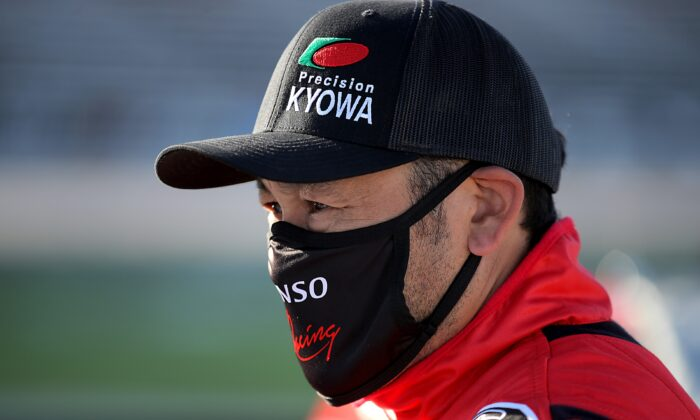 Akinori Ogata, driver of the #33 Toyota, stands on the grid prior to the NASCAR Gander RV & Outdoors Truck Series Vankor 350 at Texas Motor Speedway, in Fort Worth, Texas, on July 18, 2020. (Chris Graythen/Getty Images)