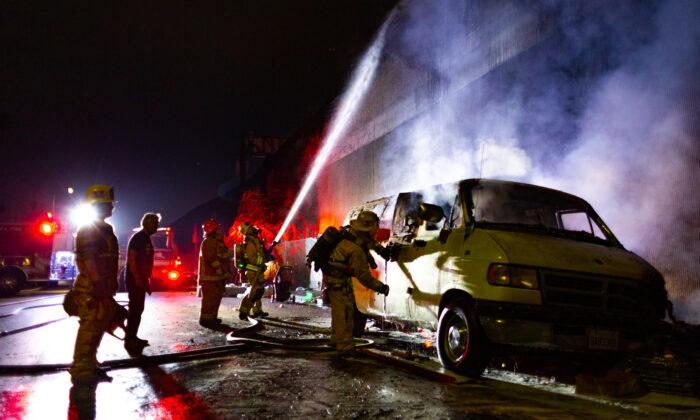 Firefighters put out a blaze in Los Angeles on Nov. 5, 2020. (John Fredricks/The Epoch Times)