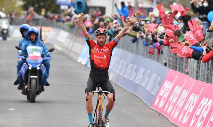 Bahrain Victorious rider Damiano Caruso of Italy celebrates winning stage 20, in Cycling—Giro d'Italia—Verbania to Valle Spluga-Alpe Motta, Italy, on May 29, 2021. (Jennifer Lorenzini/Reuters)