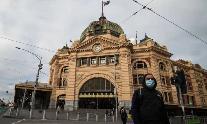 A man crosses the normally busy intersection of Flinders street and Swanston streets in Melbourne, Australia on May 28, 2021. (Darrian Traynor/Getty Images)