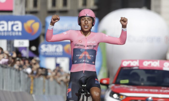 Colombia's Egan Bernal celebrates as he completes the final stage to win the Giro d'Italia cycling race, a 30.3 kilometers individual time trial from Senago to Milan, Italy, on May 30, 2021. (Luca Bruno/AP Photo)