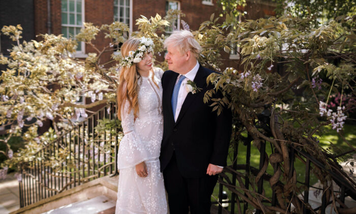 Prime Minister Boris Johnson and Carrie Johnson in the garden of 10 Downing Street after their wedding in London on May 29, 2021. (Downing Street via PA)