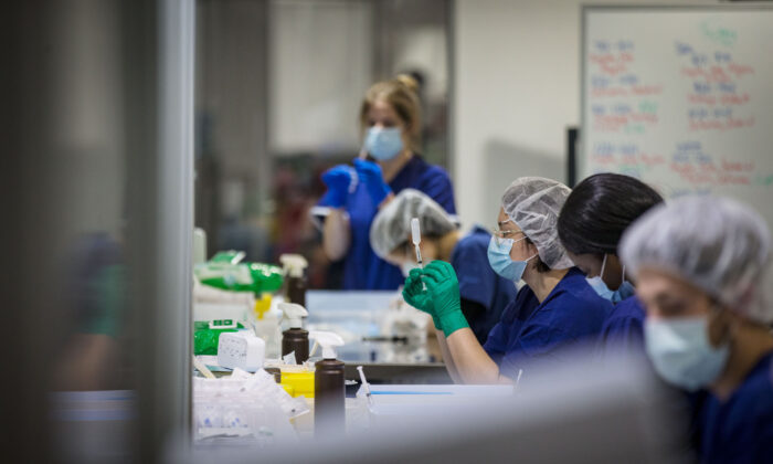 Staff are seen preparing vaccine doses inside the Melbourne Exhibition Centre COVID-19 Vaccination Centre in Melbourne, Australia on May 28, 2021. (Darrian Traynor/Getty Images)