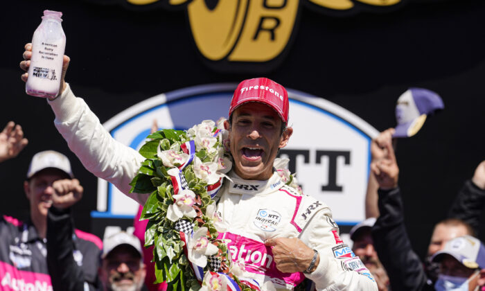 Helio Castroneves of Brazil celebrates after winning the Indianapolis 500 auto race at Indianapolis Motor Speedway in Indianapolis, on May 30, 2021. (Michael Conroy/AP Photo)
