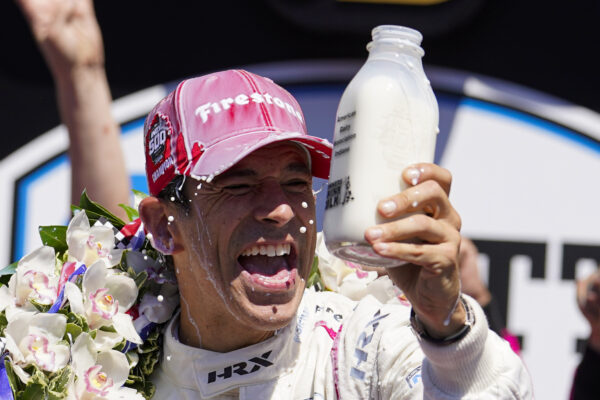 Helio Castroneves of Brazil celebrates