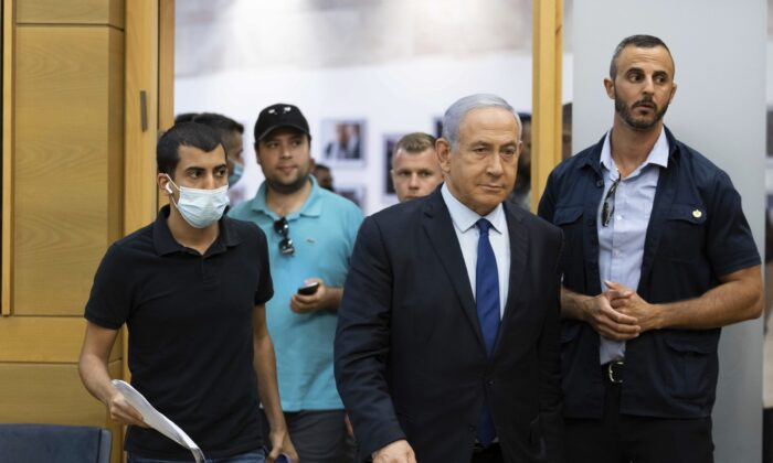 Israeli Prime Minister Benjamin Netanyahu arrives to speak to the Israeli Parliament in Jerusalem, on May 30, 2021. (Yonatan Sindel/Pool via AP)