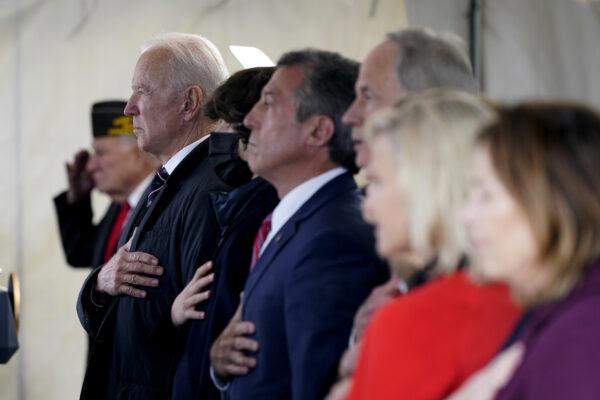 President Joe Biden stands as a rendition