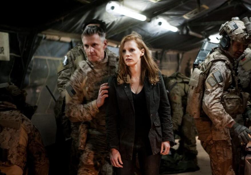 two men in military uniform and civilian woman in Zero Dark Thirty