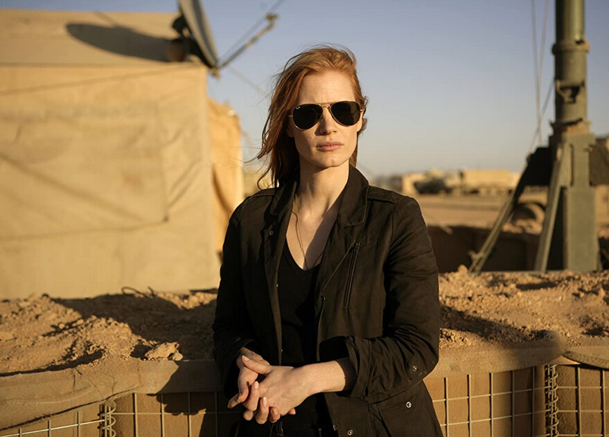woman with red hair and sunglasses in Zero Dark Thirty