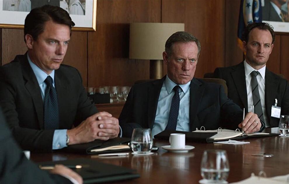 three men in suits at tabe in Zero Dark Thirty