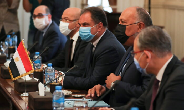 Egyptian Foreign Minister Sameh Shoukry meets with Israeli Foreign Minister Gabi Ashkenazi (not pictured) at Tahrir Palace in Cairo, Egypt, on May 30, 2021. (Mohamed Abd El Ghany/Reuters)