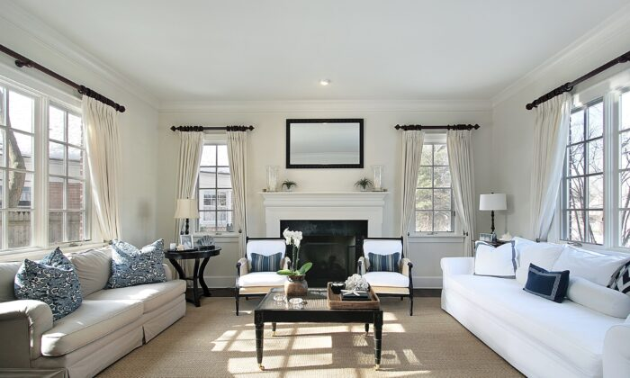 A living room that incorporates classical principles of design. The use of horizontal lines is emphasized by the crown molding and curtain rods, while the vertical lines are emphasized with the curtains. The sofas and chairs visually draw your eyes to the room's overall horizontal lines, which are reinforced with the window lines, fireplace, and coffee table. (Lmphot/Dreamstime.com)