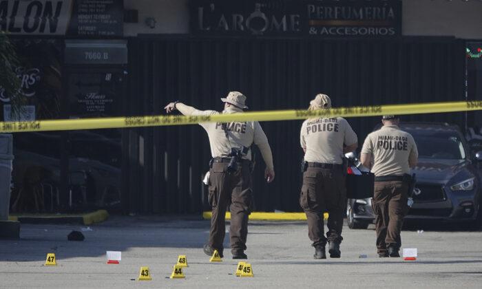 Miami-Dade Police work the scene of a shooting outside a banquet hall near Hialeah, Fla., on May 30, 2021. (Joe Cavaretta/South Florida Sun-Sentinel via AP)