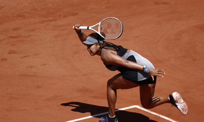 Japan's Naomi Osaka in action during her first round match against Romania's Patricia Maria Tig, in the French Open at Roland Garros, in Paris on May 30, 2021. (Christian Hartmann/Reuters)