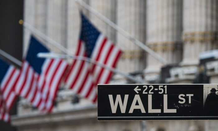 A Wall St. sign hangs near the New York Stock Exchange in New York on March 23, 2021. (Angela Weiss/AFP via Getty Images)