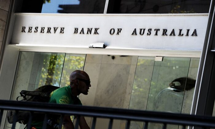 A bike courier rides past the entrance to the Reserve Bank of Australia (RBA) in Sydney's central business district on April 2, 2013. (Greg Wood/AFP via Getty Images)