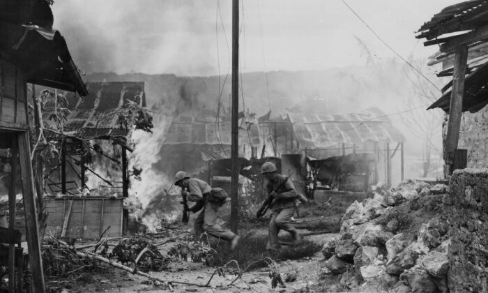 U.S. Marines moving positions during battle in Garapan, during the Pacific Campaign of World War II, on Saipan, circa 1943–1945. (U.S. Marine Corps/Getty Images)