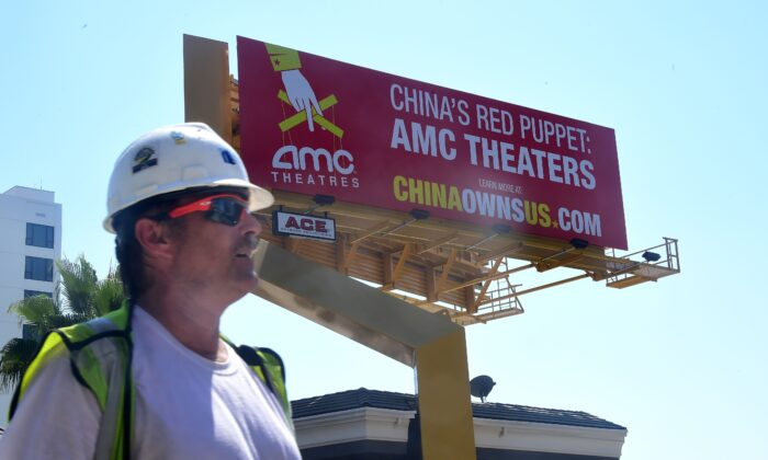 """A billboard along Hollywood's famed Sunset Strip from the Center for American Security as part of its """"China Owns US"""" campaign in Hollywood, Calif., on Aug. 29, 2016. The billboard highlights communist China's increasing influence over the U.S. movie industry, specifically AMC Entertainment, described as China's red puppet, following its 2012 sale to Chinese firm Dalian Wanda, closely aligned with the Chinese Communist Party, for $2.6 billion and control of 4,960 screens nationwide. (Frederic J. Brown/AFP via Getty Images)"""