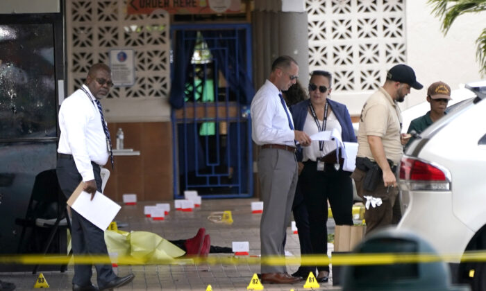Law enforcement officials work the scene of a shooting outside a banquet hall near Hialeah, Fla., on May 30, 2021. (Lynne Sladky/AP Photo)