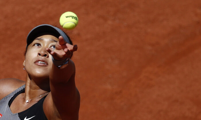 Japan's Naomi Osaka in action during her first round match against Romania's Patricia Maria Tig,French Open, Paris, France, on May 30, 2021. (Christian Hartmann/REUTERS)
