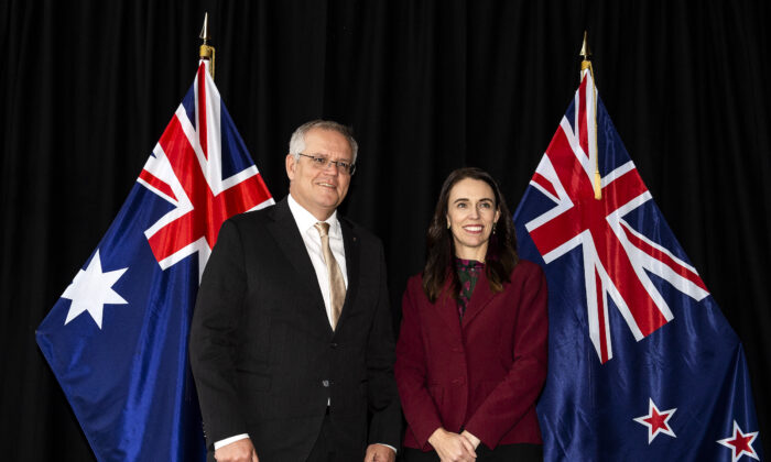 New Zealand Prime Minister Jacinda Ardern (R) poses for a photo with Australian Prime Minister Scott Morrison ahead of their annual talks in Queenstown, New Zealand, on May 31, 2021. (Joe Allison/Getty Images)