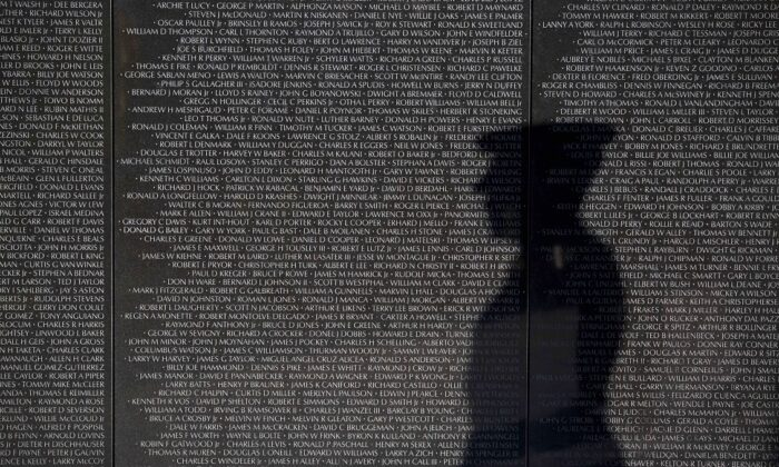 A member of the Joint Services Honor Guard is reflected on the Vietnam Veterans Memorial prior to a wreath laying ceremony to commemorate the 50th anniversary of the Vietnam War, in Washington on March 29, 2016. In 2012, President Barack Obama signed a presidential proclamation declaring March 29 Vietnam Veterans Day. (Drew Angerer/Getty Images)