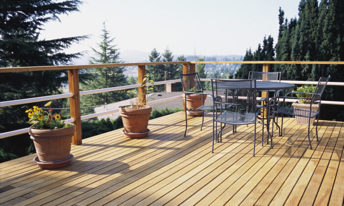 Proper maintenance can help you extend the life of your deck. (The Image Bank RF)
