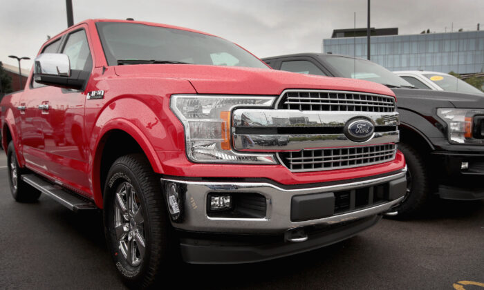 Ford F-150 pickup trucks at a dealership in Chicago on Sept. 6, 2018. (Scott Olson/Getty Images)