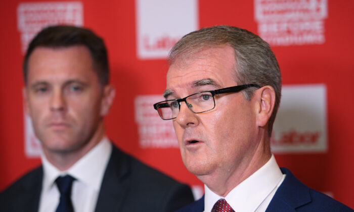 NSW Labor MP Michael Daley along with MP Chris Minns (left) address media in Sydney, Australia Jan. 31, 2019. (AAP Image/Dan Himbrechts) NO ARCHIVING