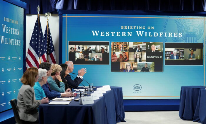 President Joe Biden holds a meeting with cabinet officials, governors and private sector partners to discuss preparedness of Western states to heat, drought and wildfires this season, at the White House in Washington, on June 30, 2021. (Kevin Lamarque/Reuters)