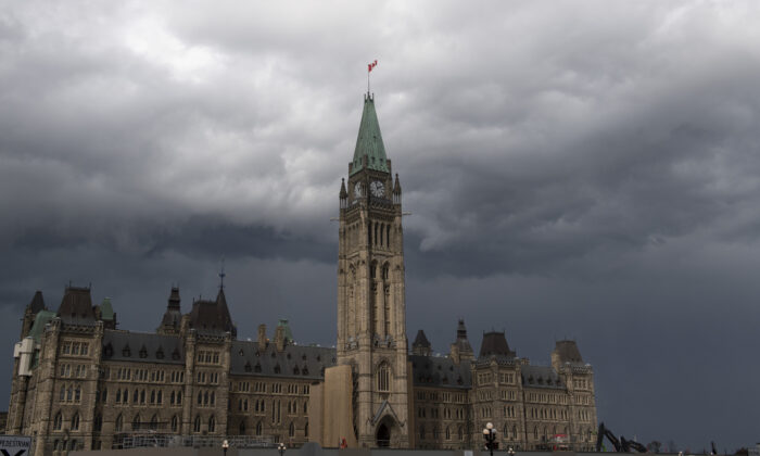 Storm clouds pass by the Peace Tower and Parliament Hill  Tuesday Aug. 18, 2020 in Ottawa. (The Canadian Press/Adrian Wyld)