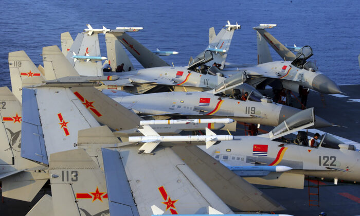 J15 fighter jets on China's sole operational aircraft carrier, the Liaoning, during a drill in the East China Seain April 2018. (AFP via Getty Images)