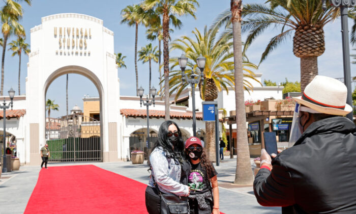 Guests attend the grand reopening media day at Universal Studios Hollywood in Los Angeles on April 15, 2021. (Amy Sussman/Getty Images)