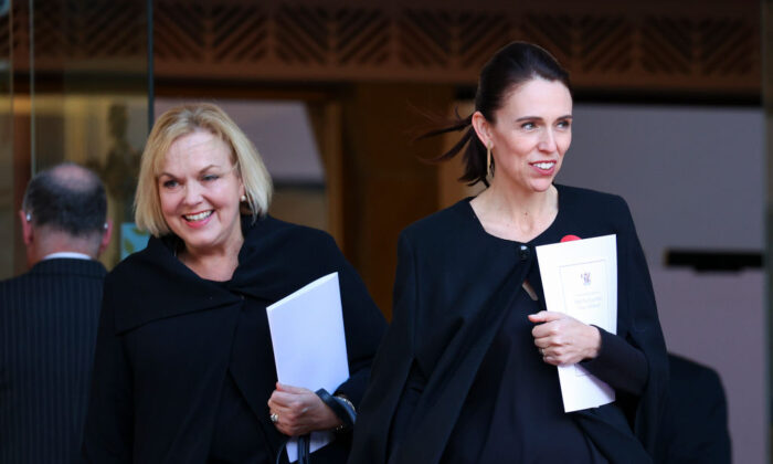 New Zealand Prime Minister Jacinda Ardern (R) and National Party leader Judith Collins look on after the State Memorial Service for Prince Philip, Duke of Edinburgh, at the Wellington Cathedral of St Paul in Wellington, NZ on April 21, 2021 (Hagen Hopkins/Getty Images)