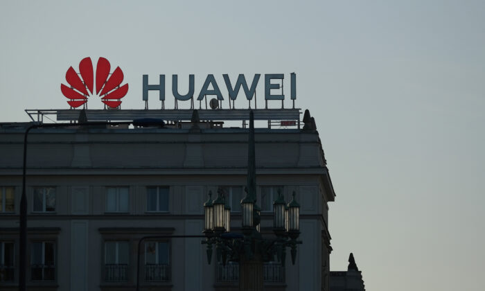 A sign advertising Chinese telecoms equipment manufacturer Huawei stands on an apartment building in Warsaw, Poland, on Oct. 11, 2019. (Sean Gallup/Getty Images)