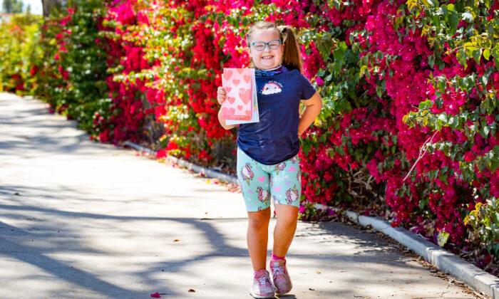 "8-year-old author Kiara ""Kiwi"" Smith in Brea, Calif., on May 24, 2021. (John Fredricks/The Epoch Times)"