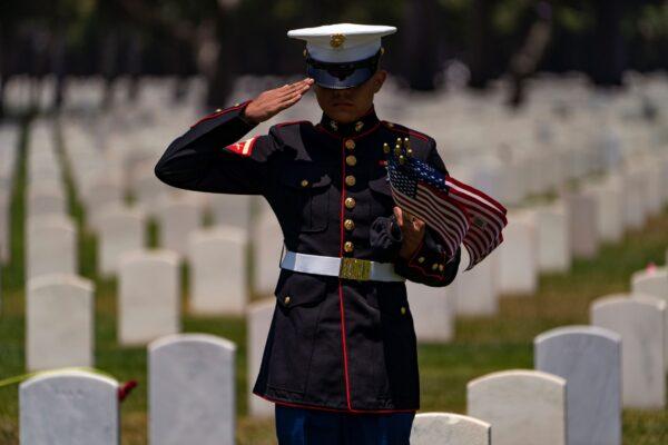 A U.S. Marine Corps salutes veterans