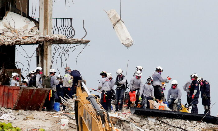 Emergency workers conduct search and rescue efforts at the site of a partially collapsed residential building in Surfside, near Miami Beach, Fla., on June 30, 2021. (Joe Skipper/Reuters)
