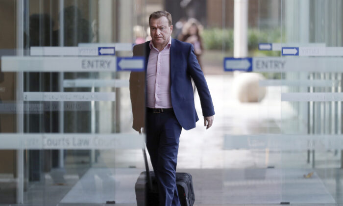 Andrew Cooper, founder and president of libertarian group LibertyWorks, arrives at Federal Court in Sydney on May 6, 2021. (AP Photo/Rick Rycroft)