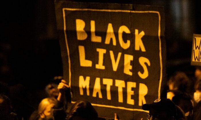 "Demonstrators holding placards reading ""Black Lives Matter"" during a protest in Philadelphia, Pa., on Oct. 27, 2020. (Mark Makela/Getty Images)"